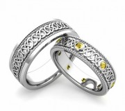 Matching wedding rings with celtic knot design and yellow sapphires
